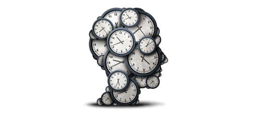Ein menschlicher Kopf aus Uhren symbolisiert Dauer