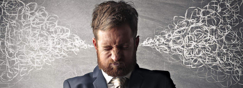 Angst- und Stressbewältigung - Mann pfeift aus den Ohren