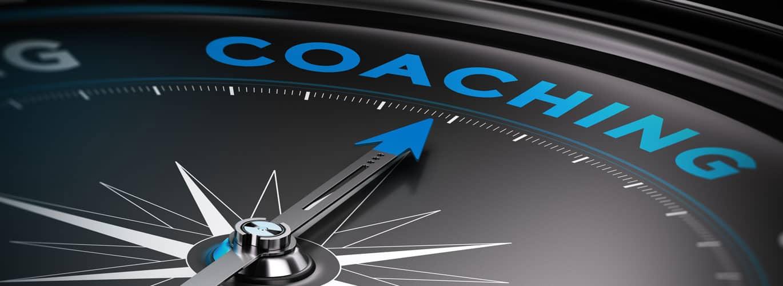 Personal und Business Coach - Zeiger zeigt auf Wort Coaching