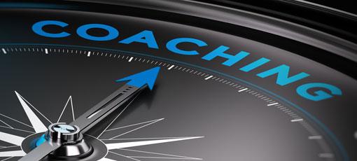 Eine Kompassnadel zeigt auf Coaching